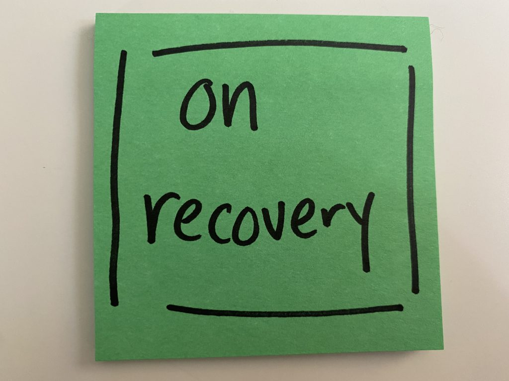 """post-it that says """"on recovery"""" in black sharpie"""